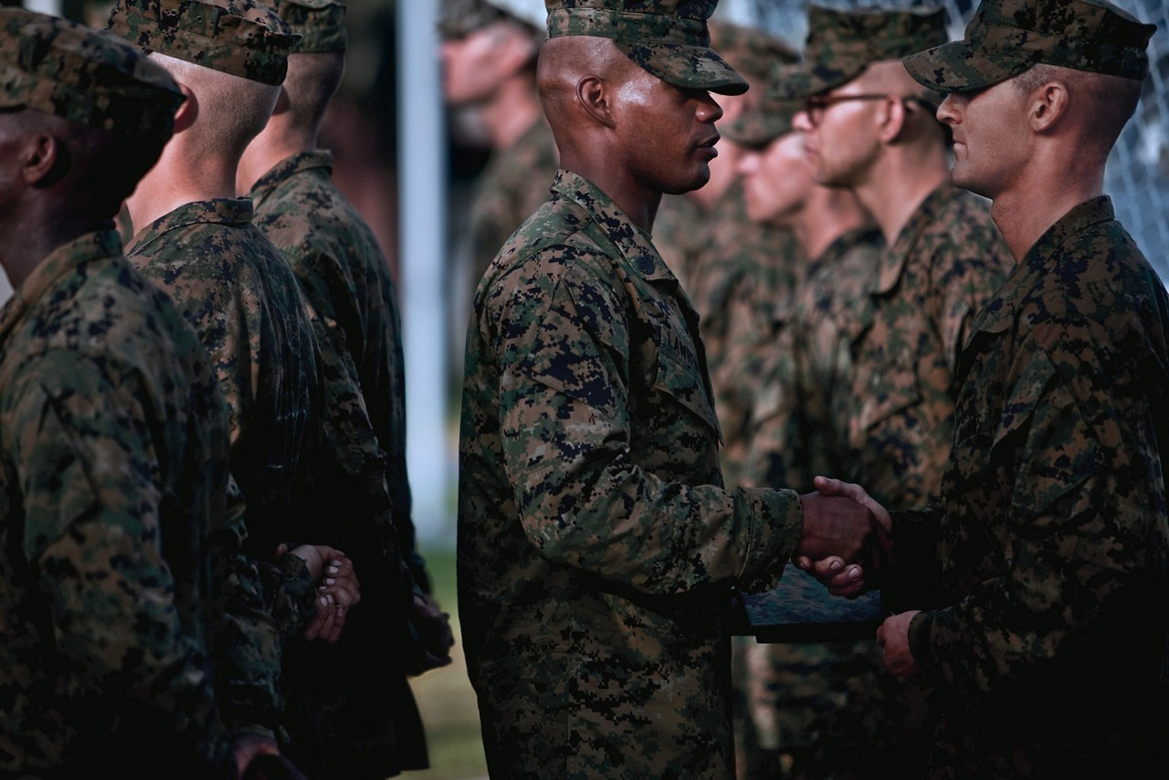 Marines receiving emblems after completing recruit training.