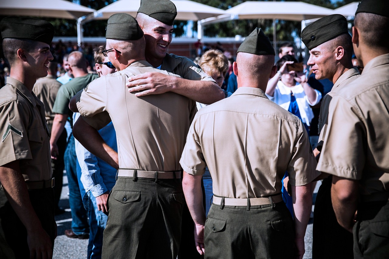 Marines congratulating each other after graduation from recruit training.