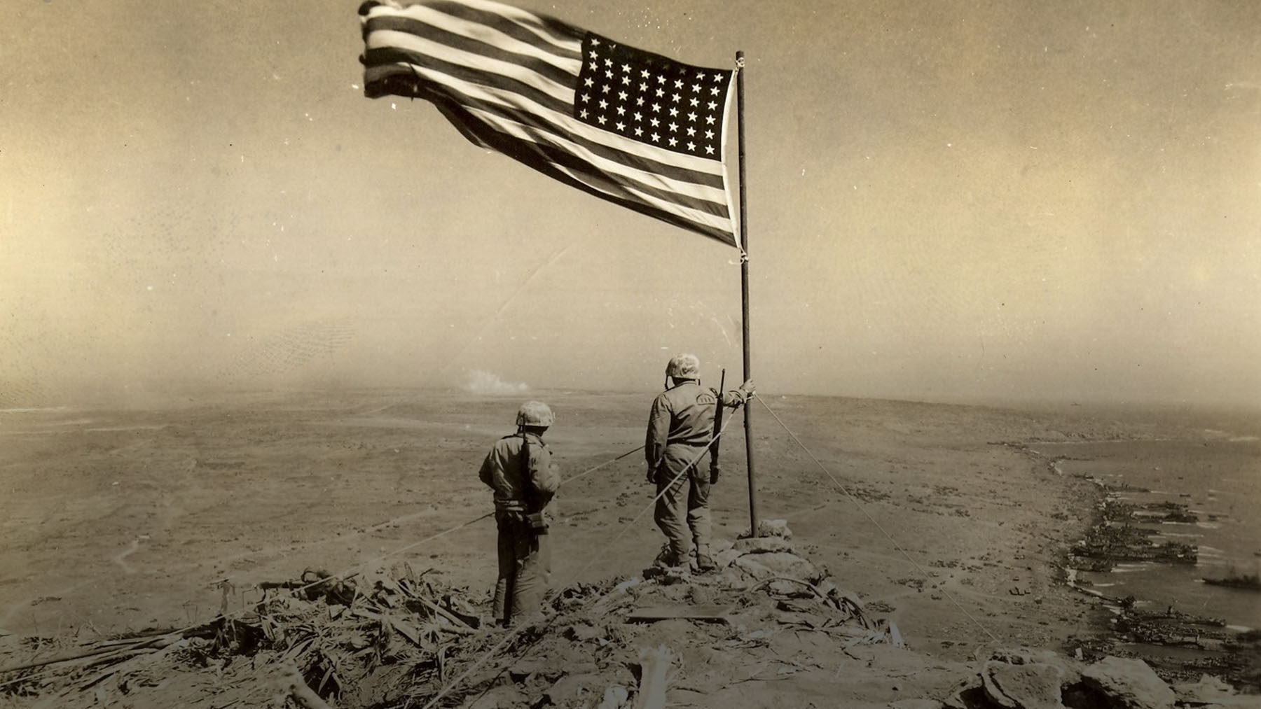 Marines raise flag on Mount Suribachi