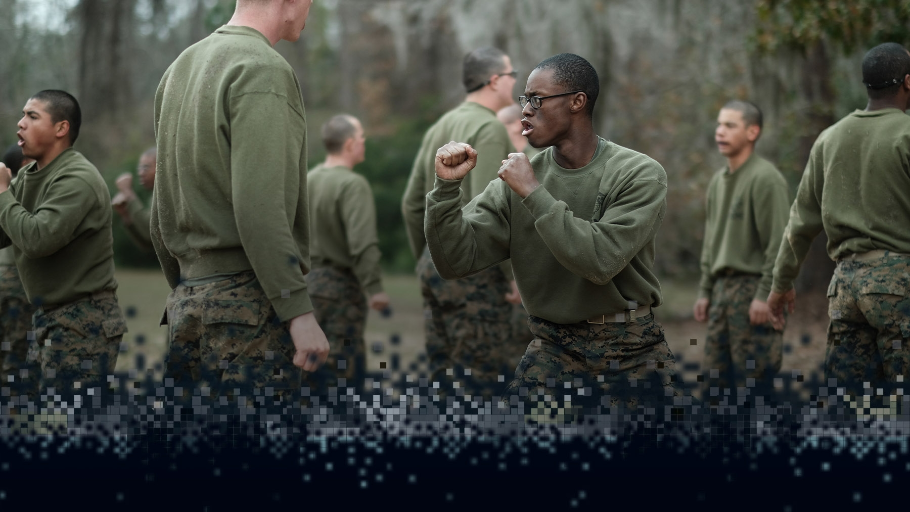 A recruit holds a martial arts stance during Marine Corps Martial Arts Program.