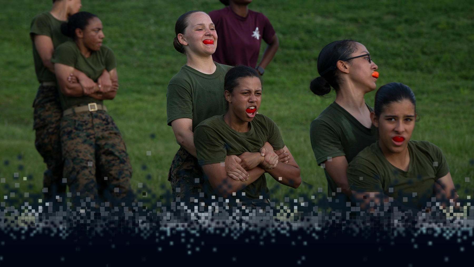 Recruits learn clPairs of recruits complete a paired training exercise.ose combat techniques with the Marine Corps Martial Arts Program.