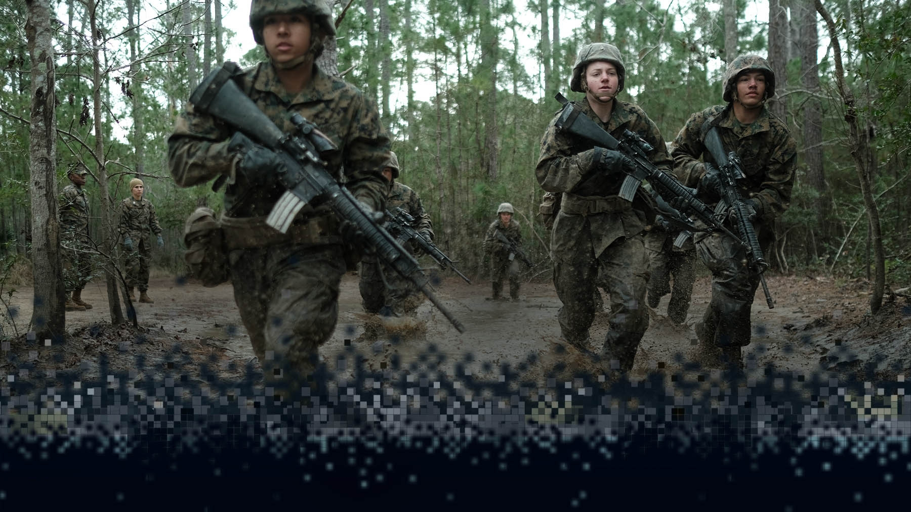 Marine recruits patrol a swamp.