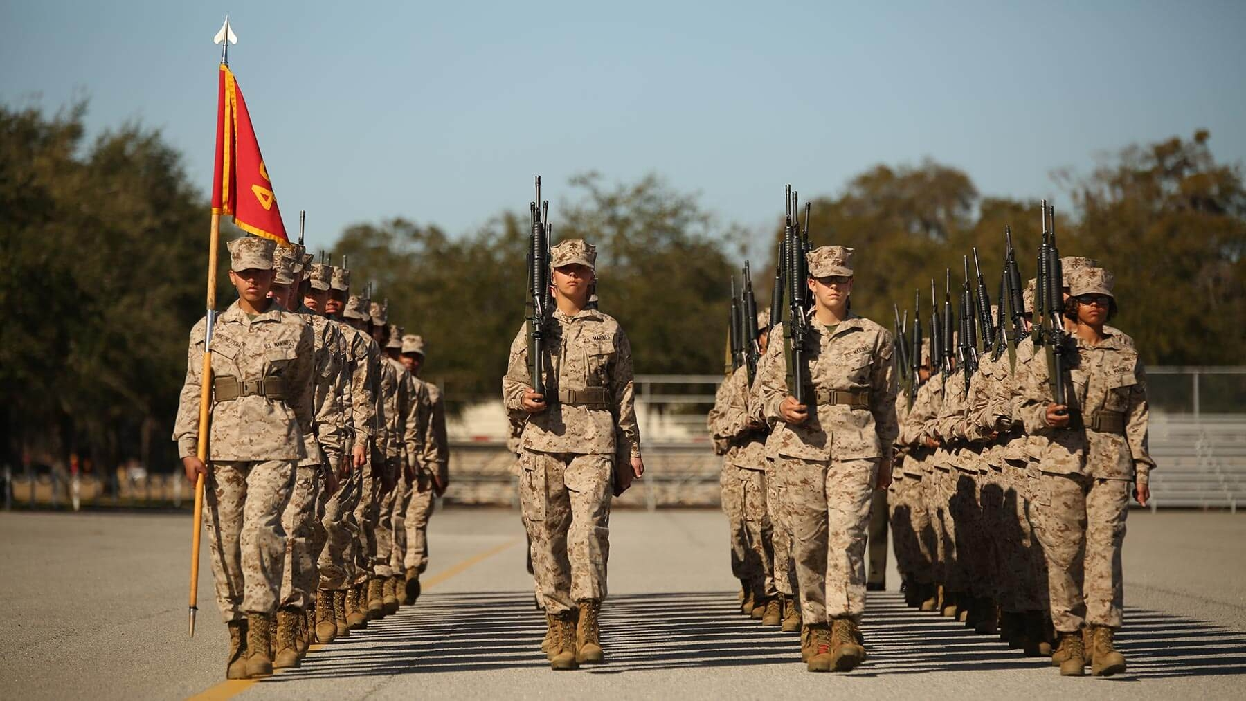 A platoon female Marine recruits marches at recruit training.