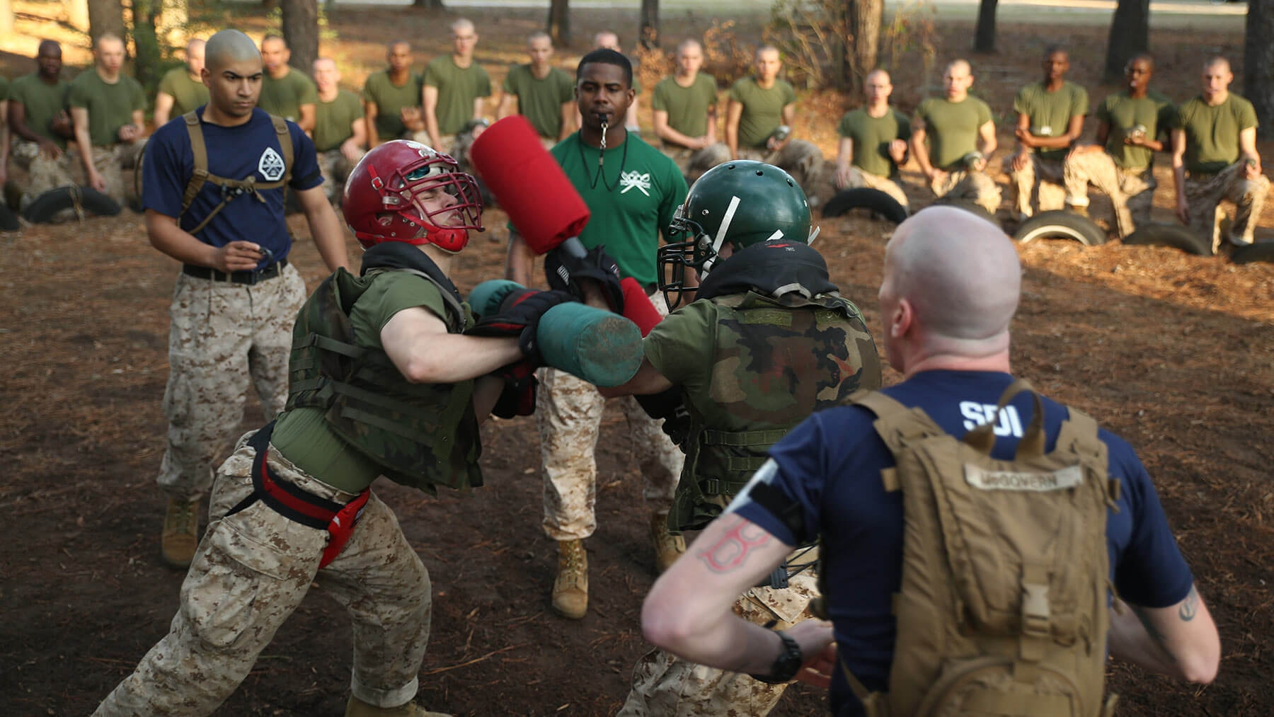 Recruits learn close combat techniques with the Marine Corps Martial Arts Program.