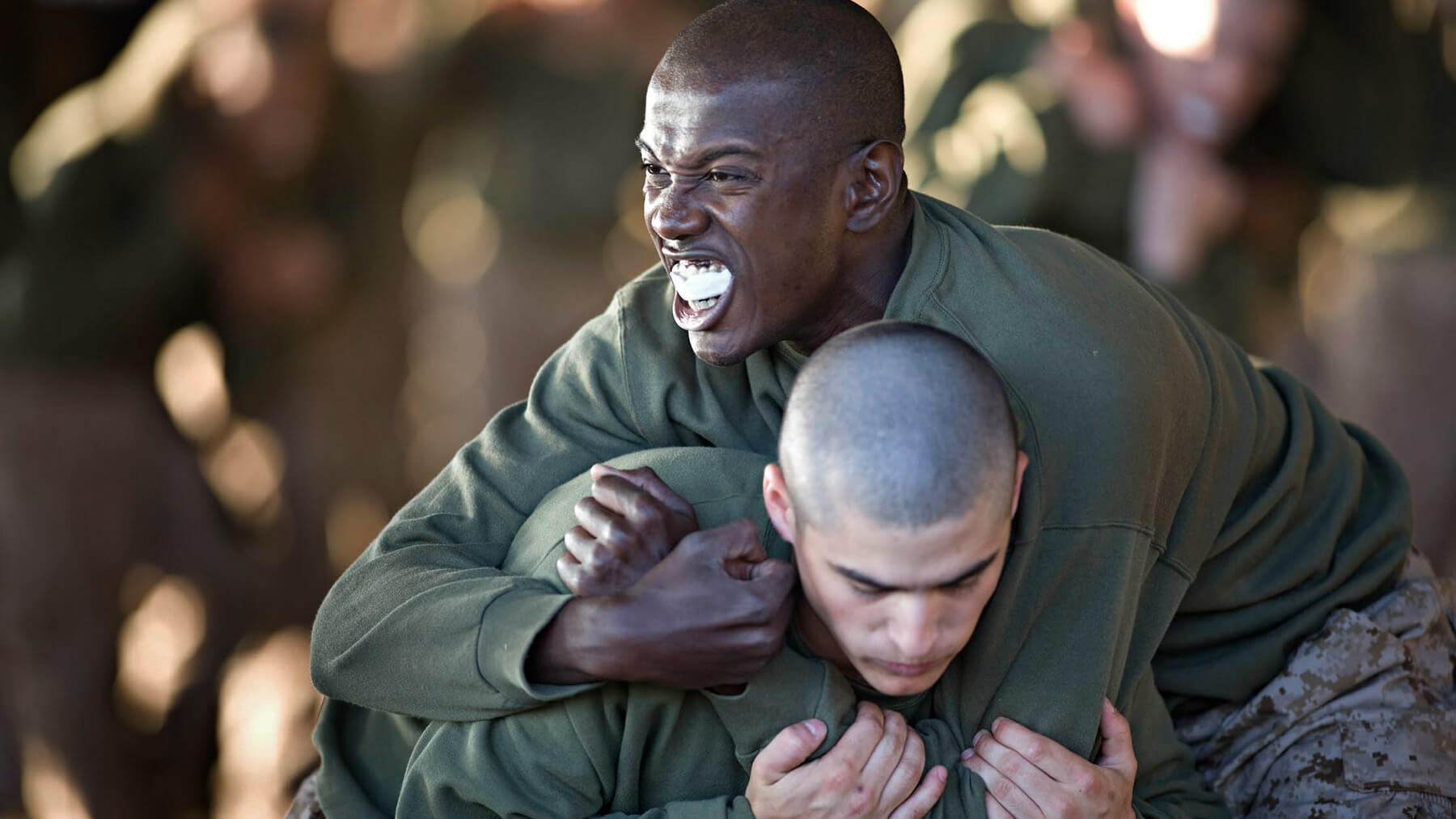 Two recruits practice fighting techniques.