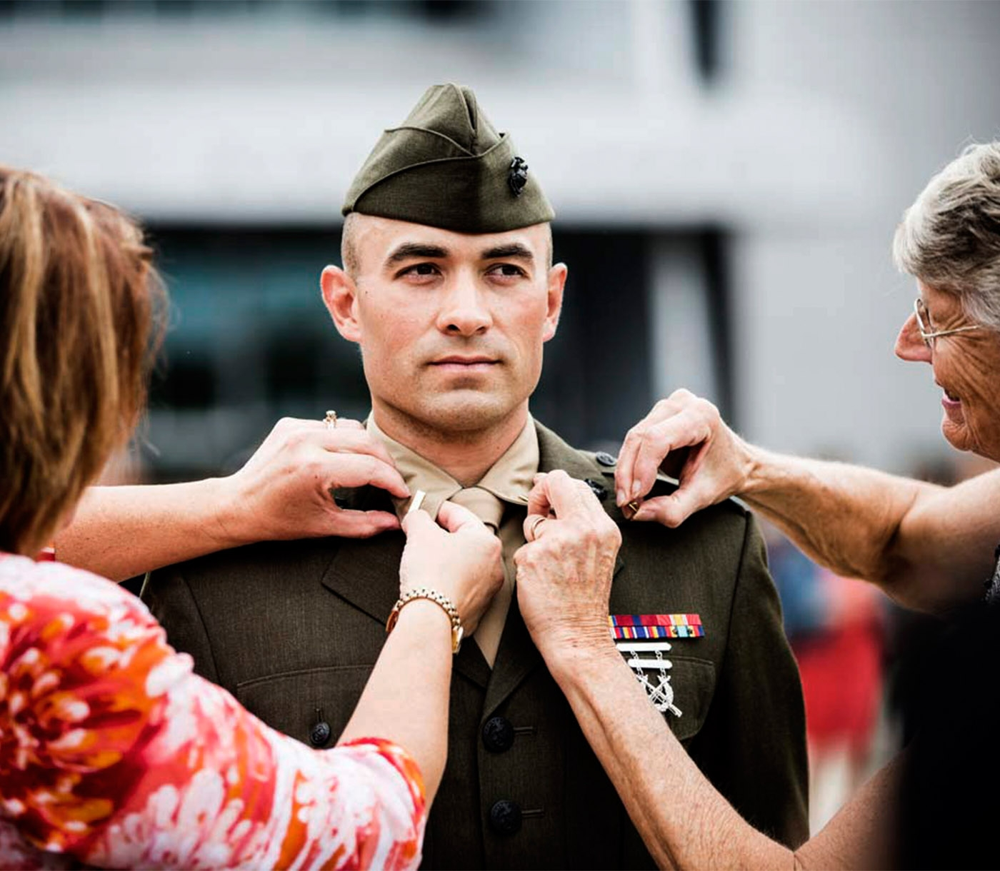 A Marine Officer is pinned by loved ones.