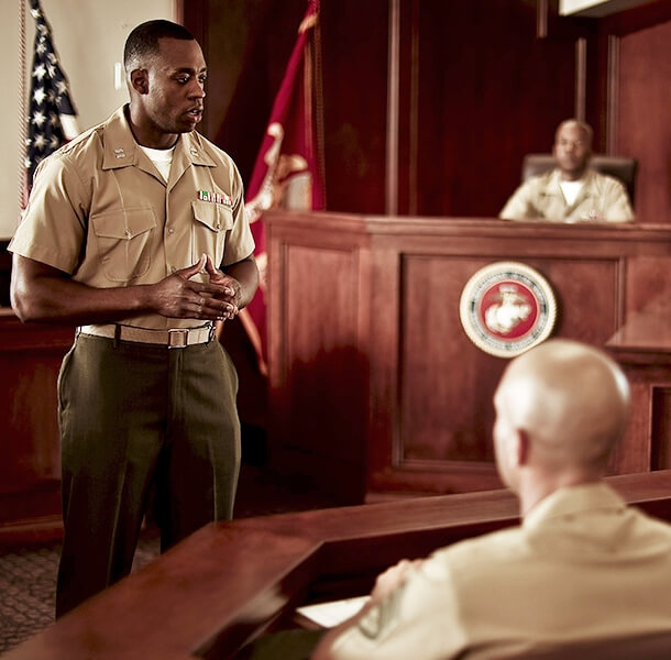 A Marine Officer and attorney presents before a military judge and jury of military personnel.