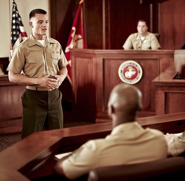 A Marine Corps Judge Advocate presents before a jury of military personnel.