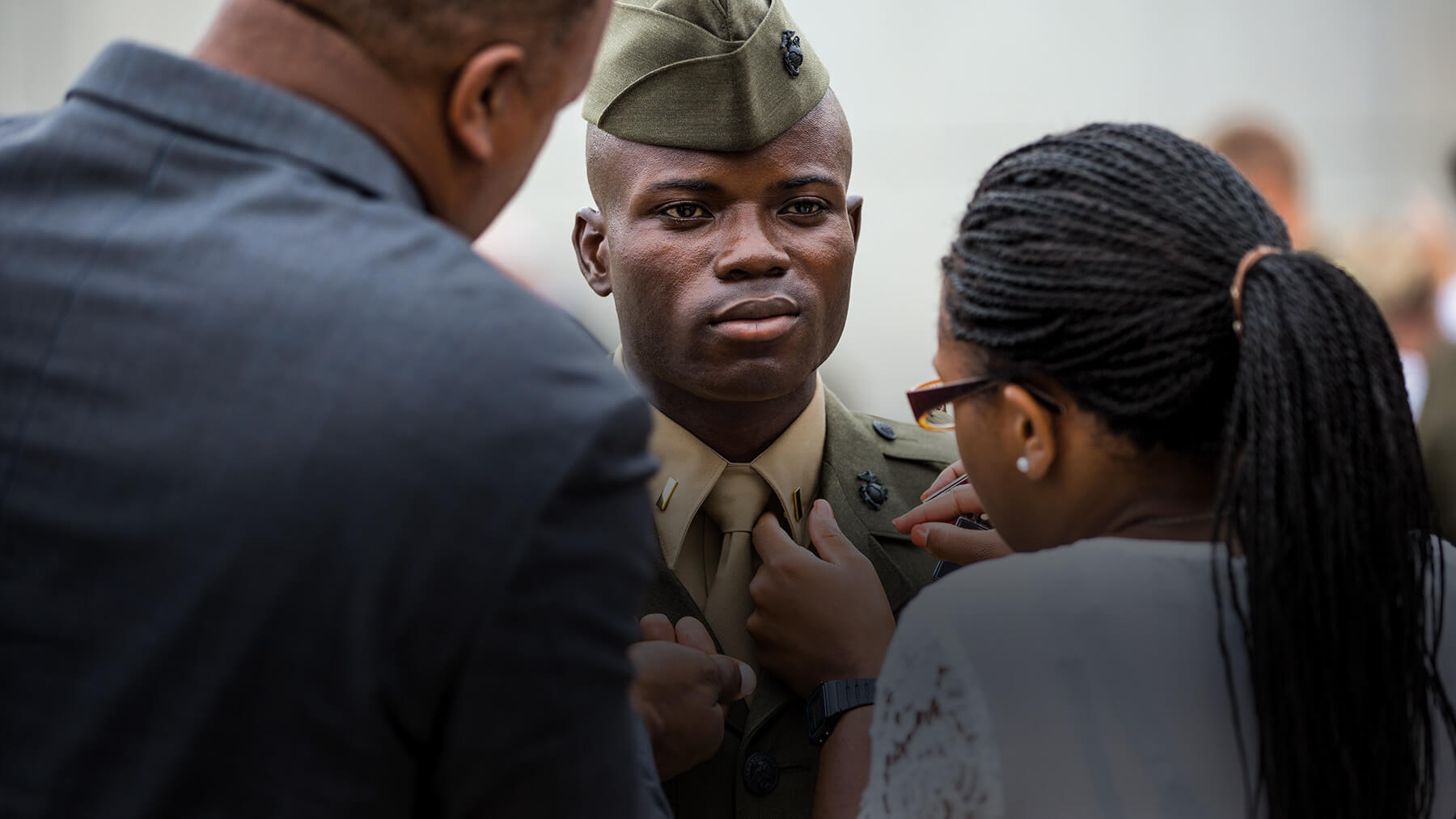 A Marine Officer is pinned by his loved ones.