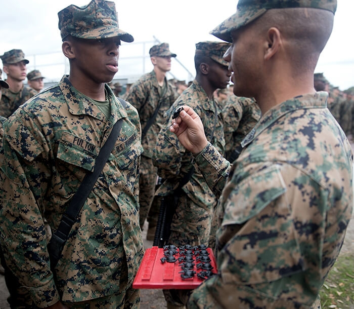 Recruits are presented with the Eagle, Globe and Anchor to signify that they have earned the title: Marine.