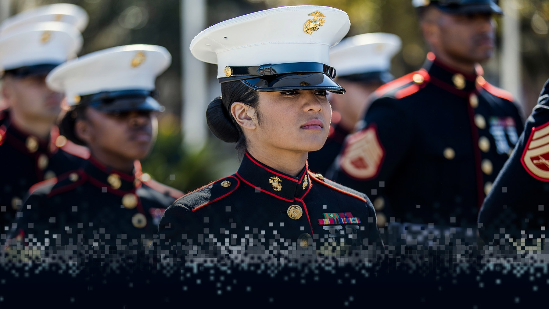 Marines in dress blues stand in formation.