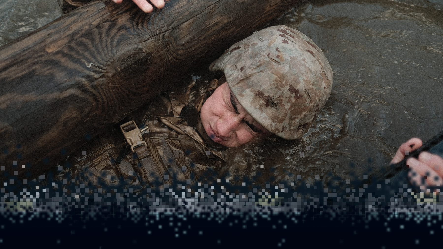 An officer candidate holds his breath before completing an underwater training obstacle.