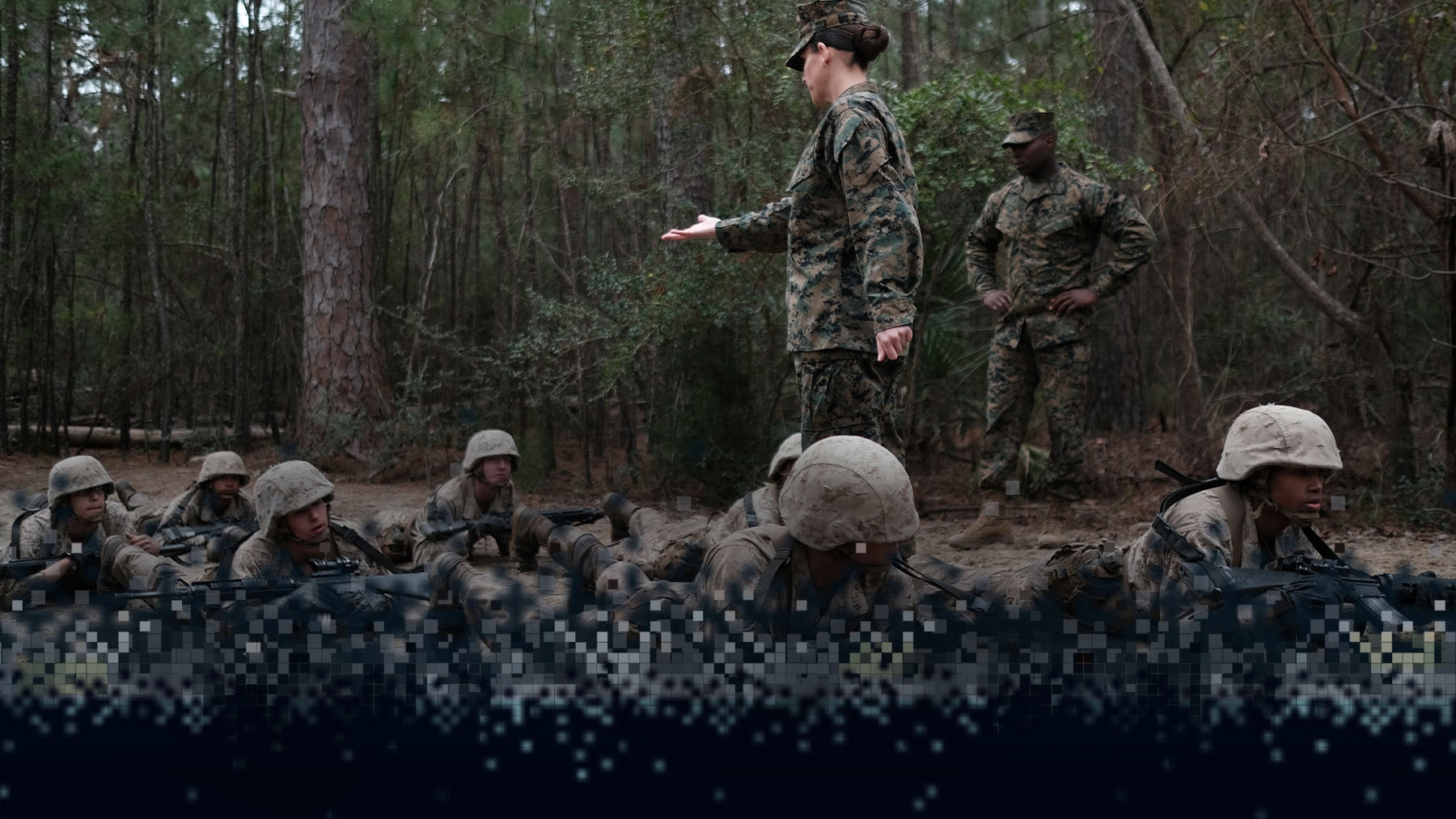 Marine recruits receive instruction from a drill instruction.