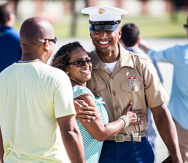 A Marine is greeted by loved ones.
