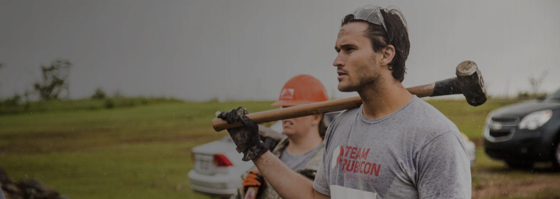 Jake Wood, Marine and Team Rubicon co-founder, clears debris following an outbreak of deadly tornadoes in Oklahoma.