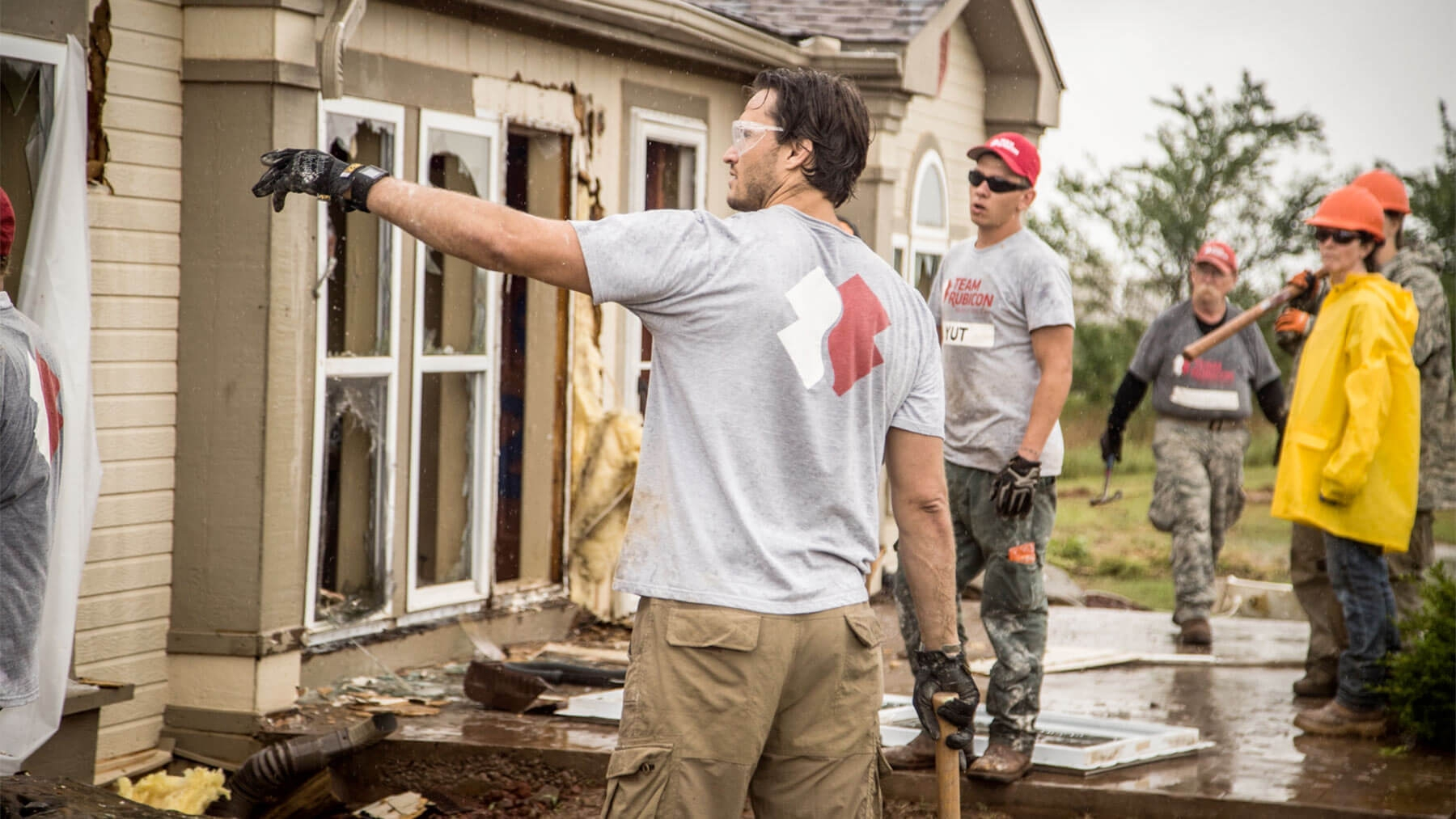 Jake Wood directs other members of Team Rubicon.