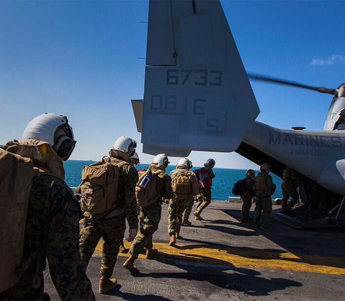 Marines board an Osprey.