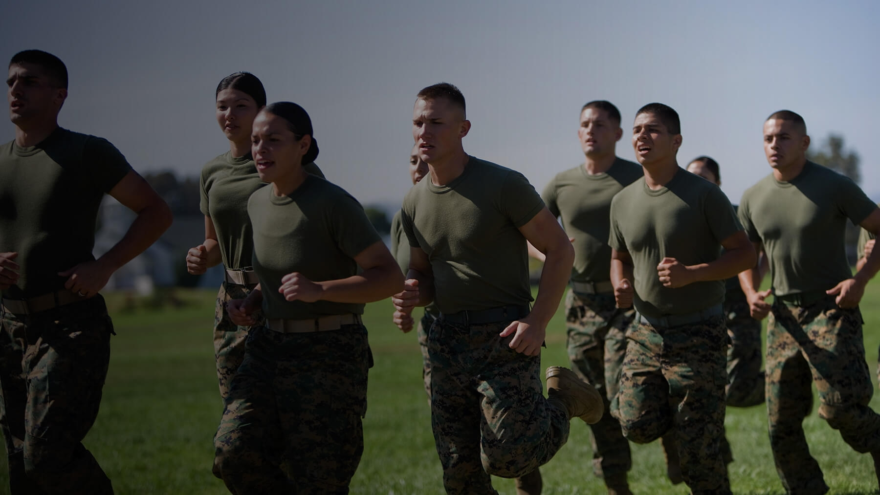 Marines, both male and female, run together.