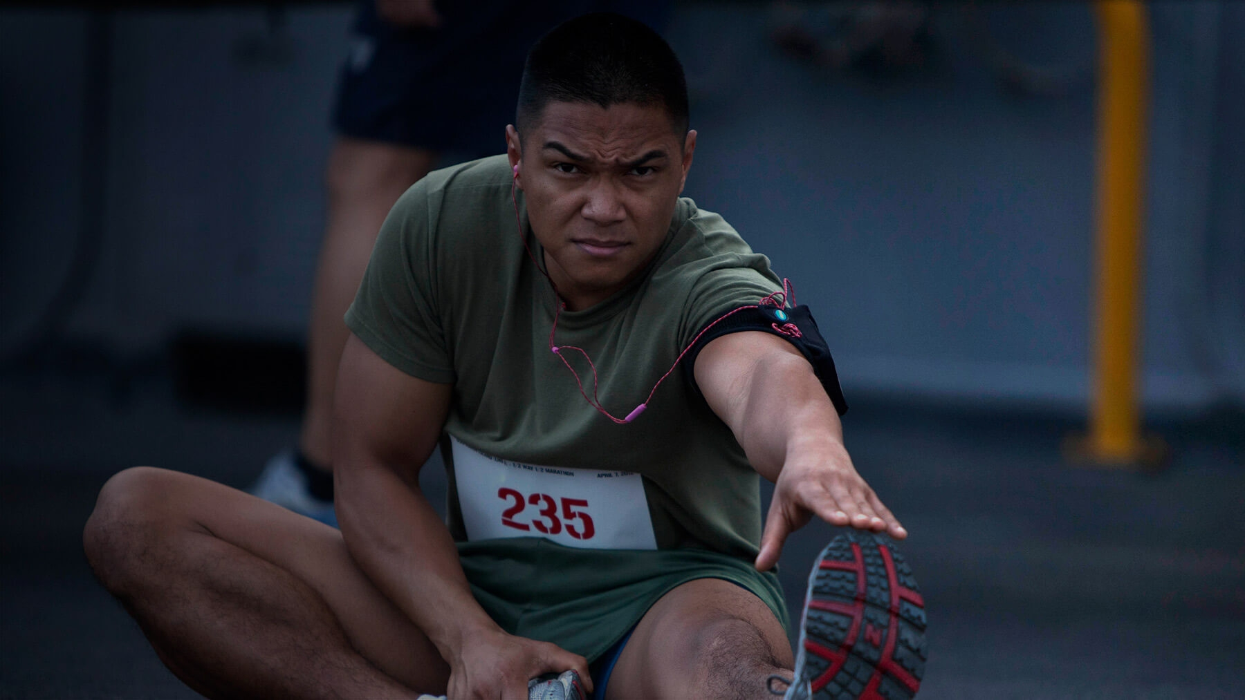 A Marine stretches before running.