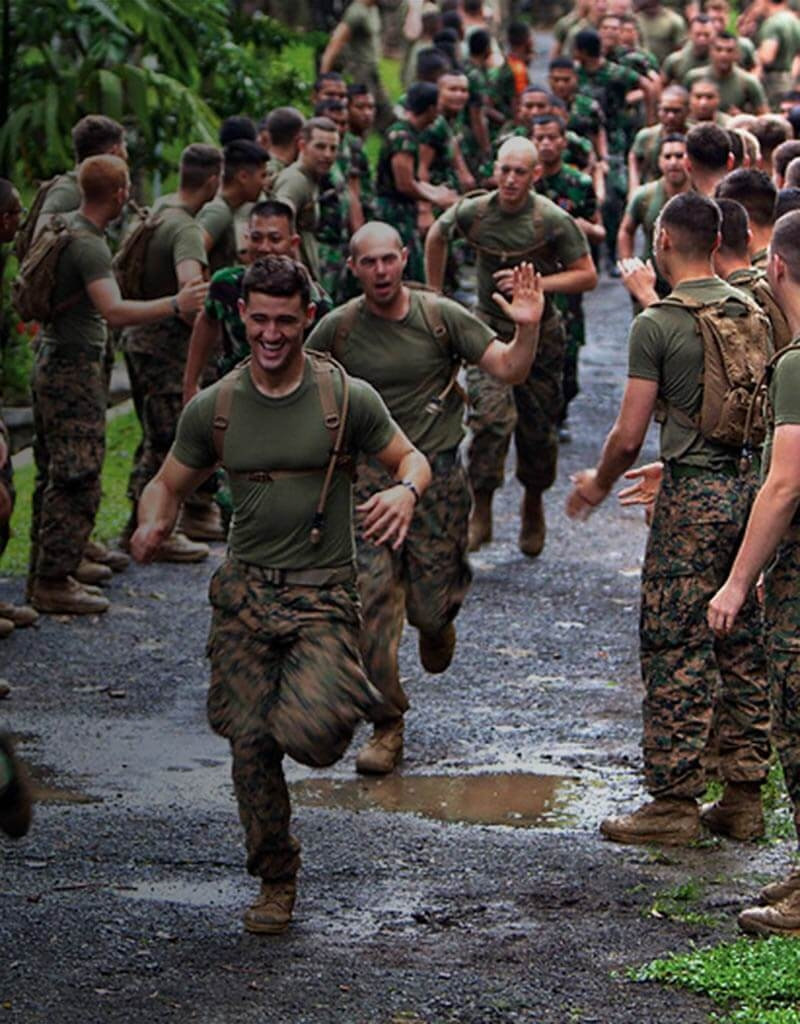 Marine corps physical fitness training requirements marines marines line both sides of a walkway and cheer own other marines that run through the nvjuhfo Gallery