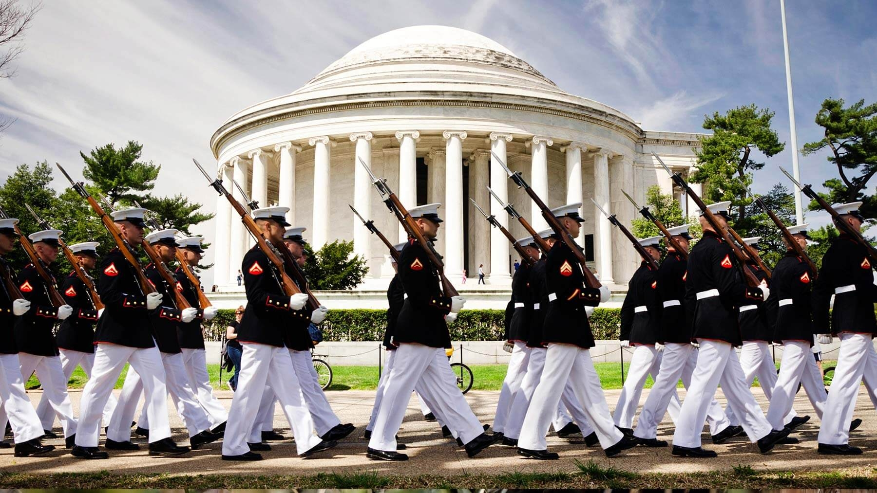 Marines with rifles and bayonets march in Washington, D.C.