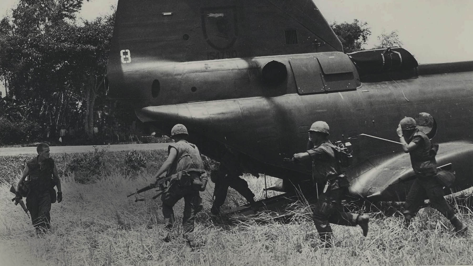 In this black and white photo from 1968, Marines board an aircraft in Vietnam.