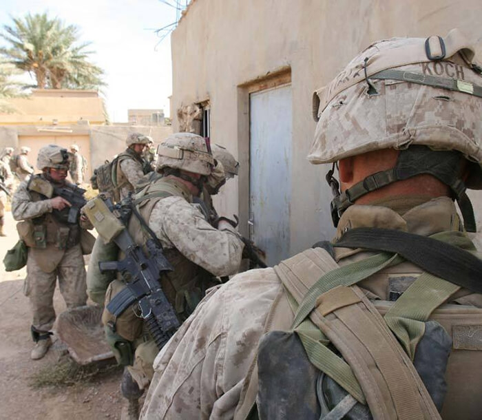 Marines prepare to enter a shelter during the Iraq War.