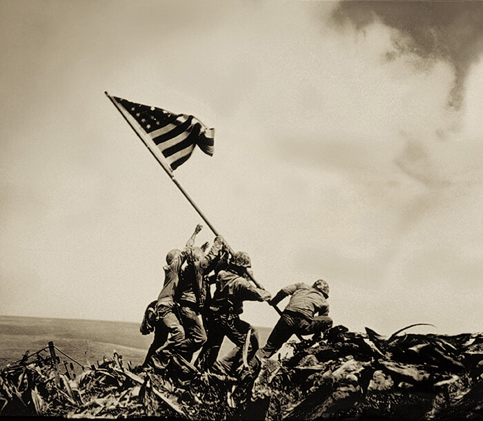 Iconic, photograph of U.S. Marines raising the American Flag at Iwo Jima.