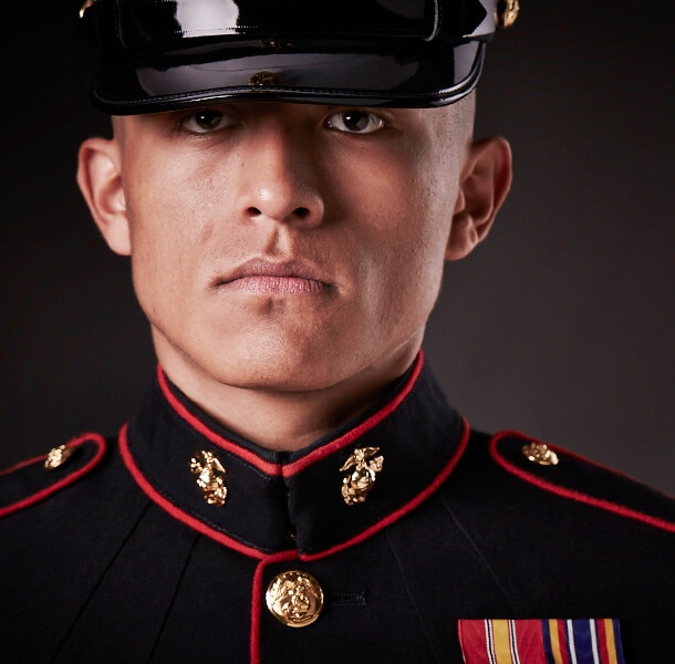 A Marine In Dress Blues Wears The Eagle Globe And Anchor Emblem