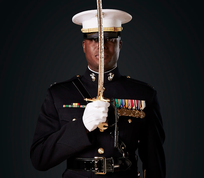 A Marine Officer stands with the Mameluke Sword.