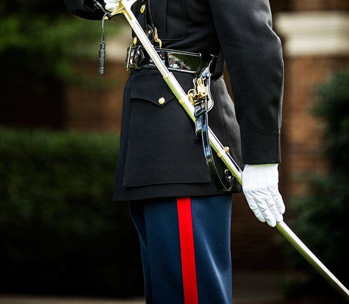 A Marine dress blue uniform shows a scarlet red stripe on the trousers known as the blood stripe.