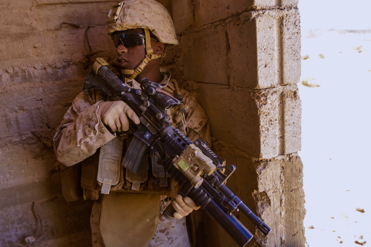 U.S. 5TH FLEET AREA OF OPERATIONS (Sept. 30, 2015) U.S. Marine Cpl. Million Suddler provides security during a military operations in urban terrain exercise. Suddler is a team leader with India Company, Battalion Landing Team 3rd Battalion, 1st Marine Regiment, 15th Marine Expeditionary Unit.  The 15th MEU, embarked aboard the ships of the Essex Amphibious Ready Group, is a forward-deployed, flexible sea-based Marine air-ground task force capable of engaging with regional partners and maintaining regional security.  (U.S. Marine Corps photo by Sgt. Jamean Berry/Released)