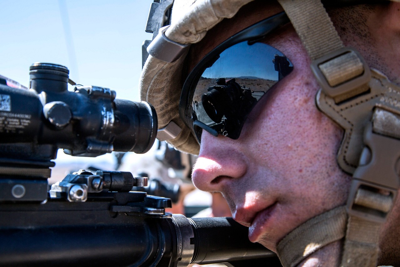 U.S. Marine Corps Cpl. Hunter R. Mansfield, machine gunner with 1st Battalion, 1st Marine Regiment, Marine Air Ground Task Force-8 (MAGTF-8) looks through his Rifle Combat Optic (RCO) from an Amphibious Assault Vehicle en route to a Mechanized Assault Course (MAC), during Integrated Training Exercise (ITX) 5-17 at Marine Corps Air Ground Combat Center, Twentynine Palms, Calif., Aug. 8, 2017. The purpose of ITX is to create a challenging, realistic training environment that produces combat-ready forces capable of operating as an integrated MAGTF. (U.S. Marine Corps photo by Sgt. Kassie L. McDole)